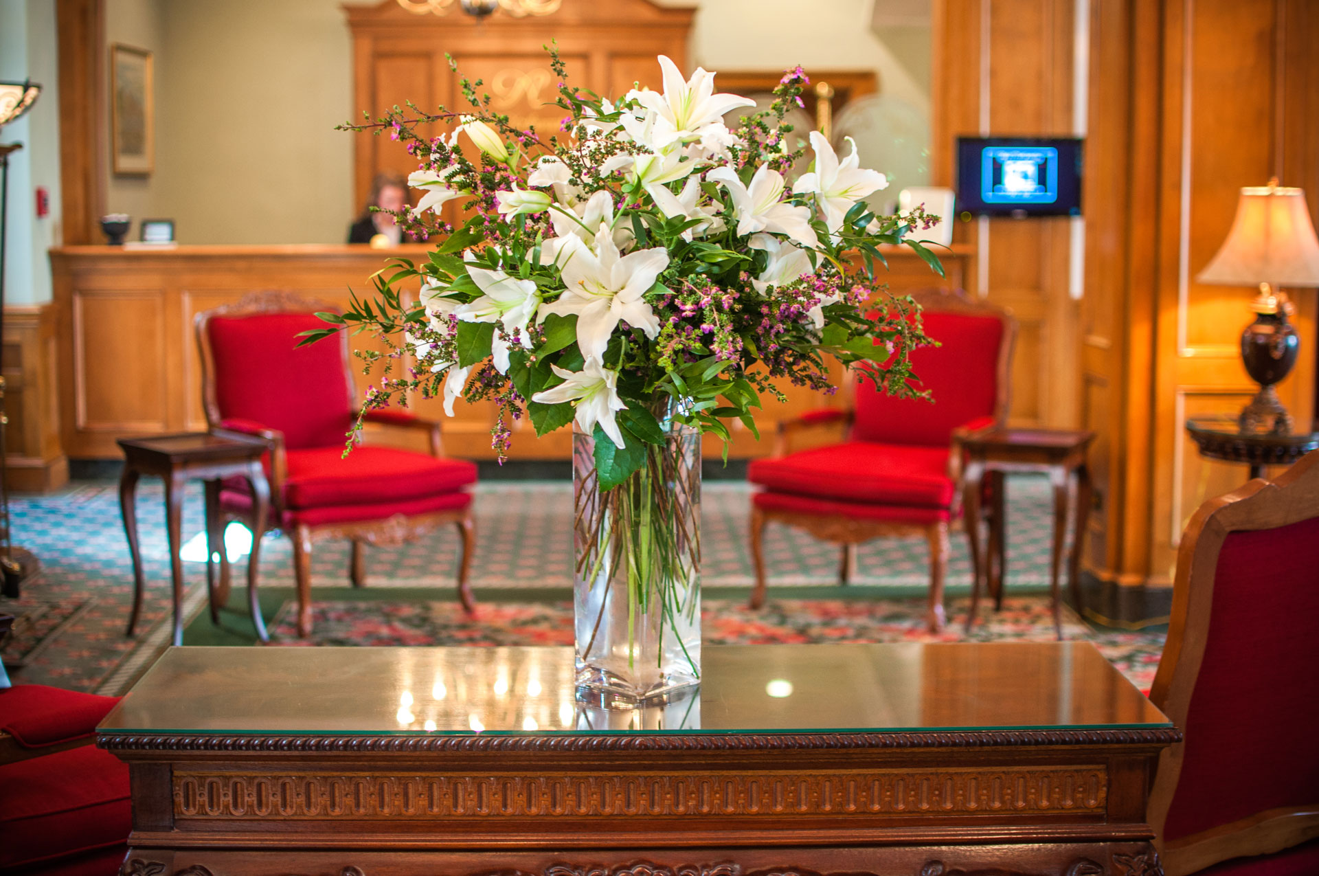 Flowers before the front desk in the Foyer