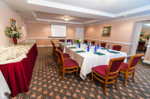 executive boardroom overview, long table and projector