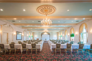 grand ballroom overview, chandeliers and long tables