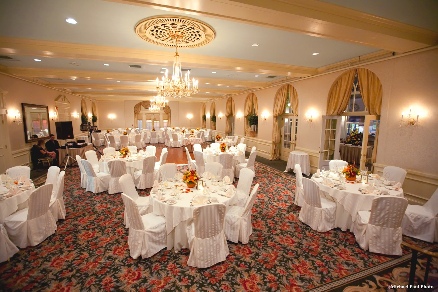 Wedding Ballroom With Chandeliers And Fall Accents