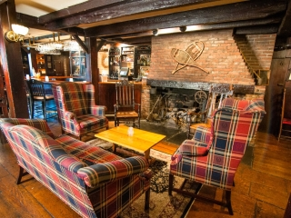 Wiggins Tavern sitting area in front of fireplace